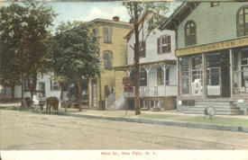 South side of Main St., site today of Rock and Snow. Yellow building on left still stands.